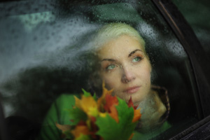 http://www.dreamstime.com/stock-photography-sad-woman-car-image21329222