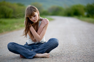 http://www.dreamstime.com/royalty-free-stock-photography-teenager-girl-sitting-road-image5129677