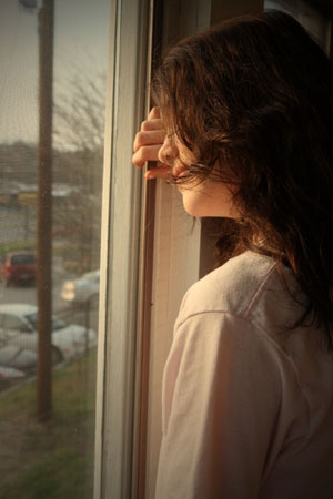 http://www.dreamstime.com/royalty-free-stock-photos-depressed-looking-out-window-image8675678