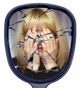 http://www.dreamstime.com/stock-photo-shattered-broken-life-woman-covers-her-face-reflected-mirror-concept-image31505310