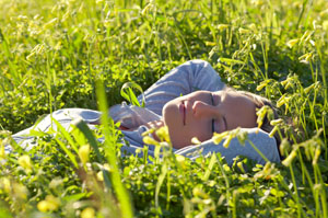 http://www.dreamstime.com/stock-photos-young-woman-laying-field-image7682543